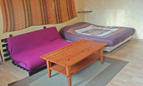 A bed or beds in a room at Studio Crosaz