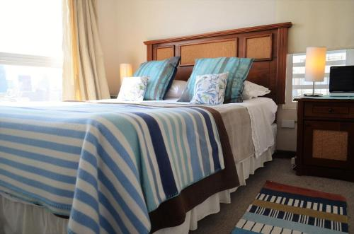 Cama o camas de una habitación en Departamentos Amoblados Paz
