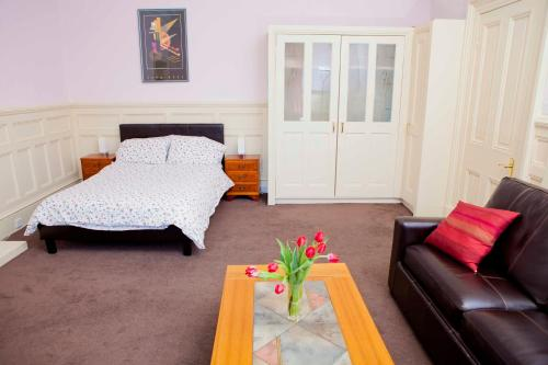 A bed or beds in a room at Palace Residential Lets