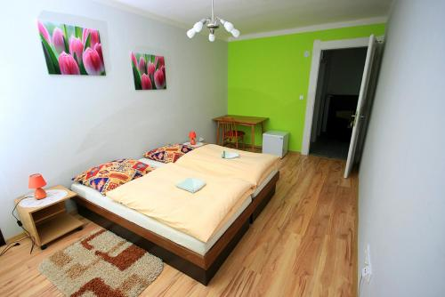 A bed or beds in a room at Privat Kohut