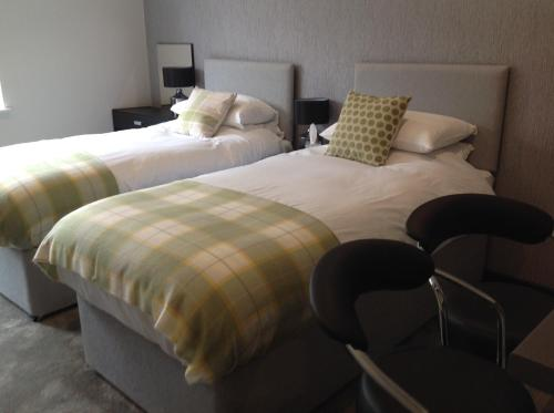 A bed or beds in a room at Rooms @ Number Six