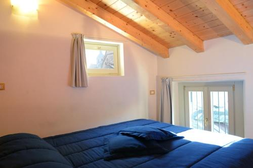Un ou plusieurs lits dans un hébergement de l'établissement Le Stanze del Lago Apartments