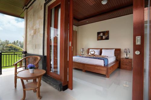 Cama ou camas em um quarto em Dewi Sri Private Villa