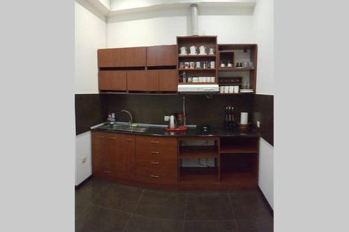 A kitchen or kitchenette at Republic Square Metro Apartment