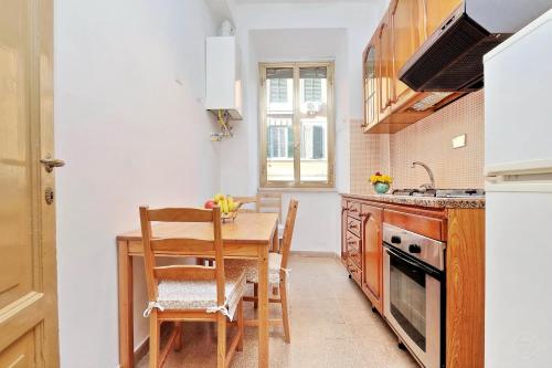 A kitchen or kitchenette at Authentic Family Apartment