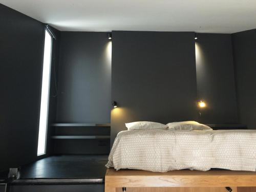 A bed or beds in a room at Ô51