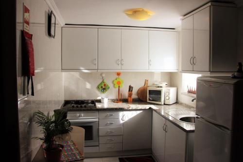 A kitchen or kitchenette at Casa do Facho