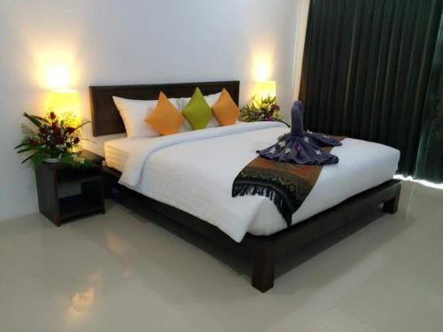 A bed or beds in a room at The Seashore Kamala Service Apartment
