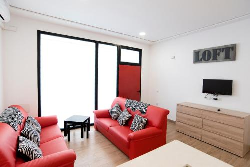 A seating area at Paterna Rent A Loft