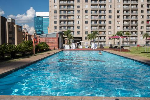 The swimming pool at or close to WeStay Westpoint Apartments