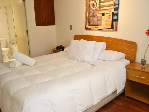 Cama ou camas em um quarto em Santiago Suite Apartment
