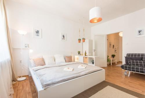 A bed or beds in a room at Na Zborenci Design Apartments