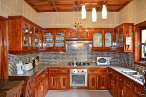 A kitchen or kitchenette at Villa Pasyon