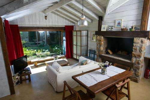 Un restaurant u otro lugar para comer en Villa Constancia