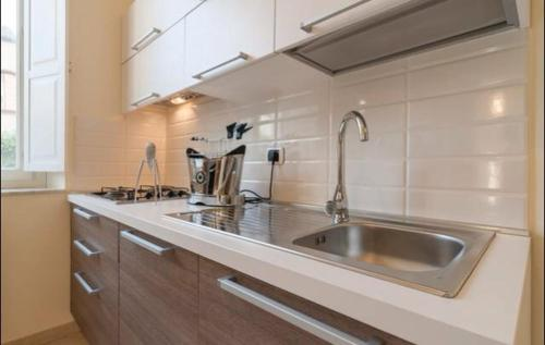 A kitchen or kitchenette at The villas apartment