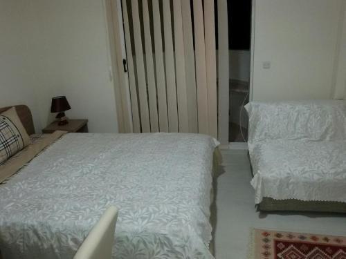 Кровать или кровати в номере Apartment Metulevi