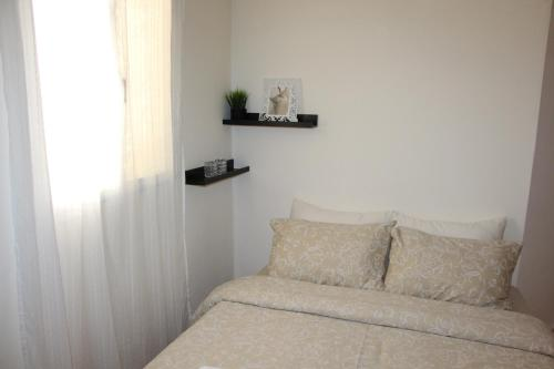 A bed or beds in a room at Country Vibe Villa In The City