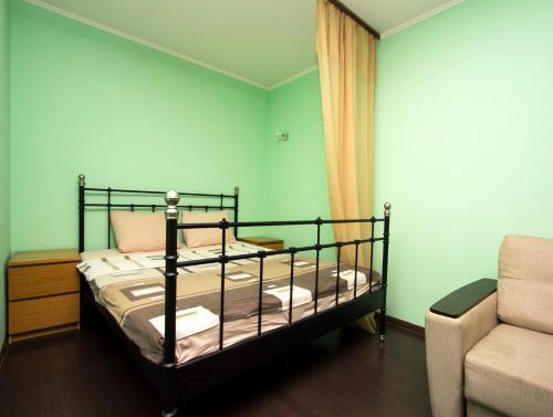 A bed or beds in a room at ApartLux Yugo-Zapadnaya Studio