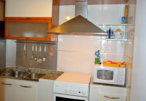A kitchen or kitchenette at Apartamentos de las Heras