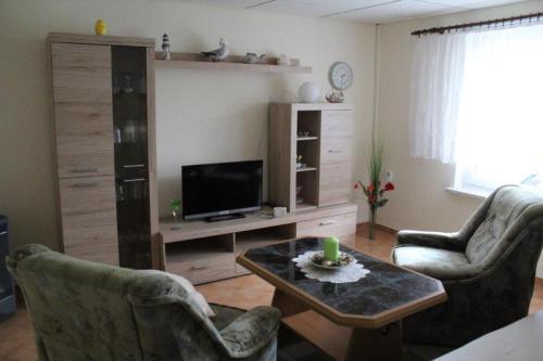 Ein Sitzbereich in der Unterkunft Ferienhaus in Neubukow