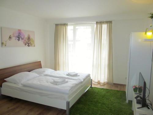 Ένα ή περισσότερα κρεβάτια σε δωμάτιο στο Dlouha Apartments City Center