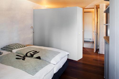 Een kamer bij Quatre Mains Serviced Apartments