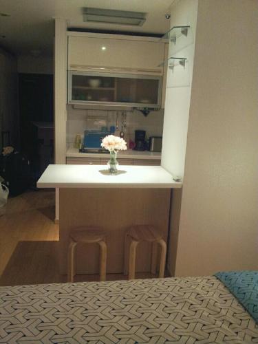 A kitchen or kitchenette at Kims Studio