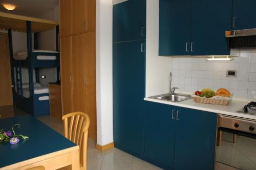 Kuchyň nebo kuchyňský kout v ubytování Aparthotel Albatros