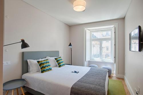 A bed or beds in a room at Chiado Square Apartments | Lisbon Best Apartments