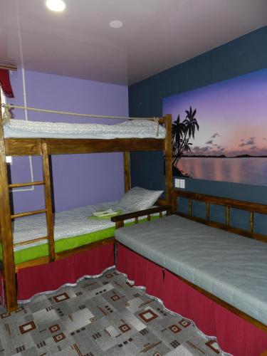 A bunk bed or bunk beds in a room at Hostel Uralskie Gori
