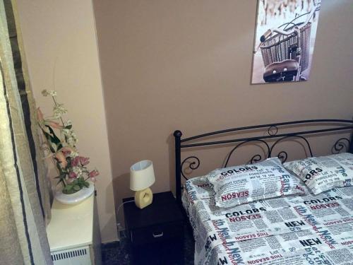 Ένα ή περισσότερα κρεβάτια σε δωμάτιο στο Kalispera Apartment