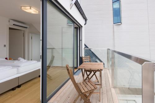 Ein Balkon oder eine Terrasse in der Unterkunft Yourapartment City Center