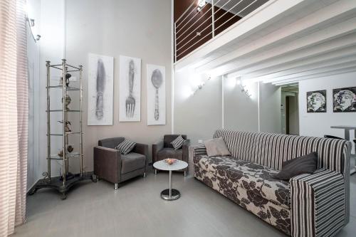Area soggiorno di Quattro Canti Apartments