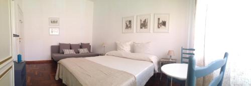 A bed or beds in a room at Essentia