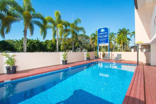 The swimming pool at or near Cairns City Palms