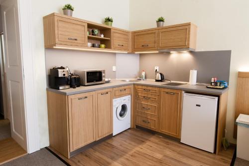 מטבח או מטבחון ב-Karlova 25 Apartments