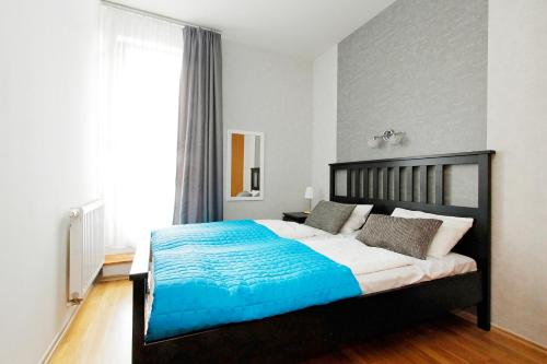 A bed or beds in a room at Park Residence Budapest