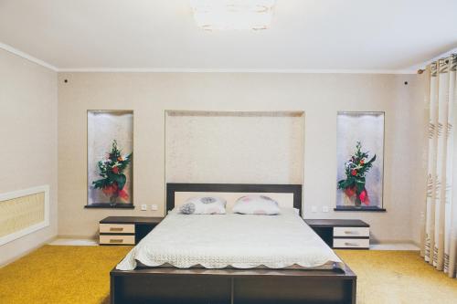 Кровать или кровати в номере Usadba Medovay