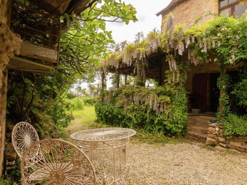 A garden outside Cozy Cottage in Aquitaine with Fireplace