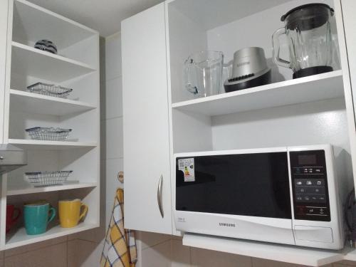 Una cocina o zona de cocina en Bellapart Santiago