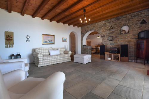 The lounge or bar area at Tinos Sky View Villa