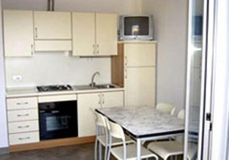 A kitchen or kitchenette at Residence Maxime