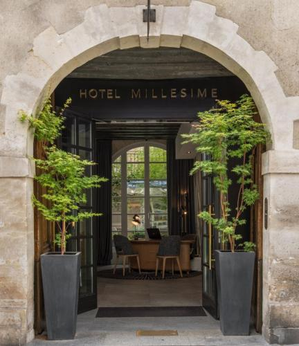 A patio or other outdoor area at Millésime Hôtel