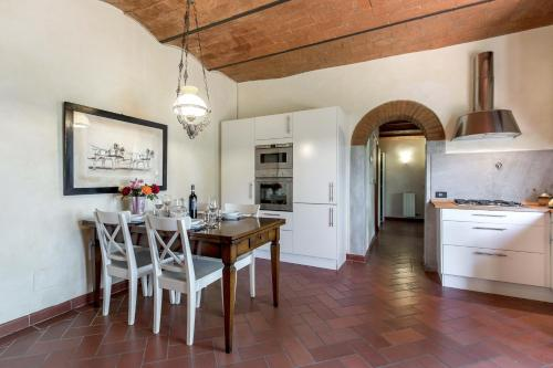 A kitchen or kitchenette at Monteripaldi Borgo House
