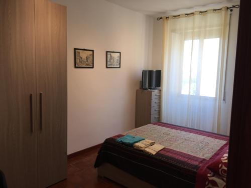 Een bed of bedden in een kamer bij Roma Giovane