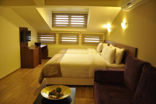 Lova arba lovos apgyvendinimo įstaigoje Vogue Suites Taksim