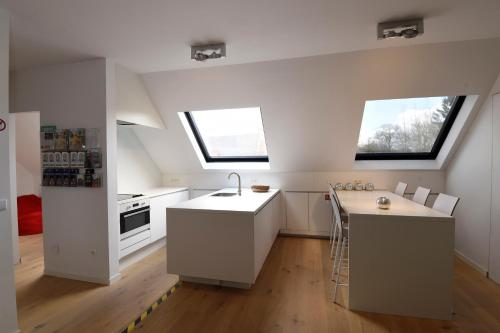 A kitchen or kitchenette at Stay in Ghent