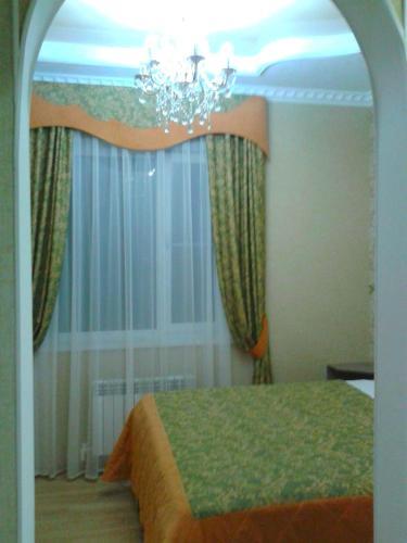 Кровать или кровати в номере Отель Арго