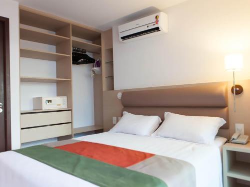 Cama ou camas em um quarto em Beach Class Residence Service