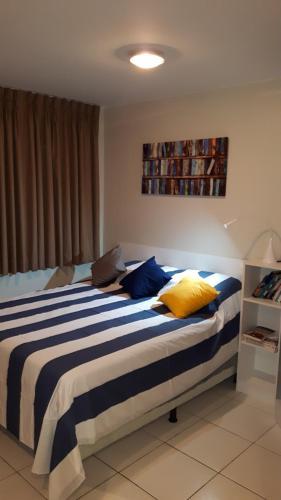 A bed or beds in a room at Villa Verde Suites Sudoeste
